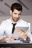 Young businessman with digital tablet Royalty Free Stock Images