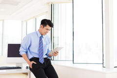 Young Businessman with Digital Tablet in Office Stock Photos