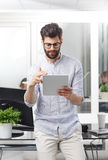 Young businessman with digital tablet Royalty Free Stock Photo