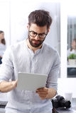 Young businessman with digital tablet Stock Photos