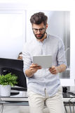 Young businessman with digital tablet Royalty Free Stock Photos