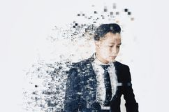 Young businessman with dispersing and disintegrating into particles effect. Over white background royalty free stock photo
