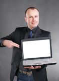 Young businessman displaying laptop Stock Images