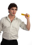 Young businessman, a doer, ready for action. Young, handsome businessman with rolled-up sleeves and measuring stick, ready for action Stock Image