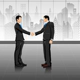 Young Businessman doing handshake Royalty Free Stock Images