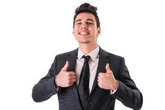 Young businessman doing thumbs up sign Stock Images
