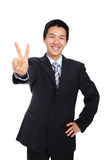 Young businessman doing the victory sign Royalty Free Stock Photo