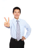 Young businessman doing the victory sign on white Stock Images