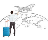 Young businessman drawing airplane and world map Stock Photography