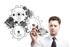 Young businessman drawing gears Stock Photos