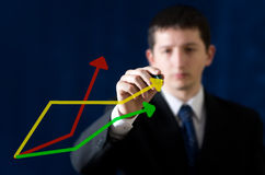 Young businessman drawing graph Royalty Free Stock Images