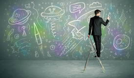 Young businessman drawing rocket Stock Image