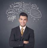 Businessman with speech bubbles Stock Photos