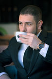 Young businessman drink tea at the cafe Royalty Free Stock Photography