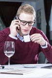 Young businessman drinking coffee Royalty Free Stock Image
