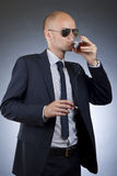 Young businessman drinking and smoking Stock Photo