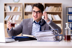 The young businessman drinking from stress Stock Photography