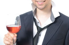 Young businessman drinking wine. Isolated on white Stock Photo