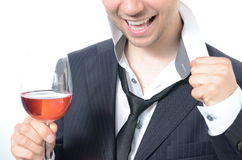Young businessman drinking wine. Isolated on white Stock Images