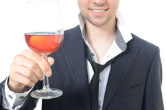 Young businessman drinking wine. Isolated on white Royalty Free Stock Photo