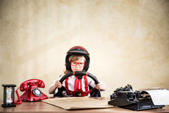 Young businessman. Driver child businessman in office. Success, creative and start up business concept Stock Photo