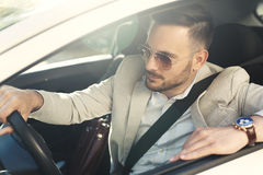 Young businessman driving car royalty free stock image