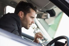 Young businessman driving while drunk Royalty Free Stock Photography