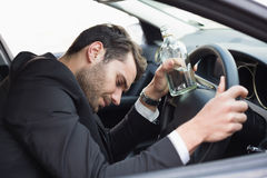 Young businessman driving while drunk Stock Photo
