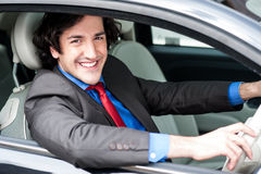 Young businessman driving his car Royalty Free Stock Images
