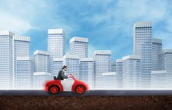 Young businessman driving a toy car Royalty Free Stock Image