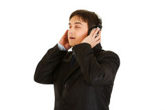 Young businessman in earphone listening music Stock Photo