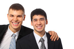 Young businessman embraces another for shoulder Royalty Free Stock Photos