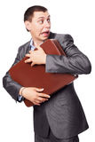 Young businessman embraces portfolio Stock Photos