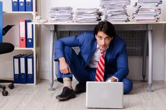 The young businessman employee unhappy with excessive work. Young businessman employee unhappy with excessive work royalty free stock photography