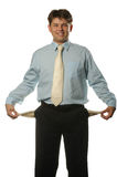 The young businessman with empty pockets Royalty Free Stock Image