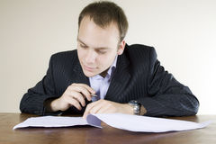 Young businessman enjoying signing contracts Royalty Free Stock Images