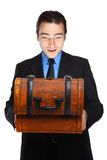 Young businessman excited about a treasure box Royalty Free Stock Photography