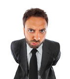 Young businessman with expression of indecision. On white background royalty free stock photos