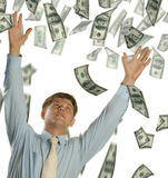 The young businessman falling dollars Stock Photos