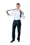 The young businessman Fastens a tie Stock Image