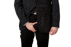 Young businessman feeling pain in his crotch. Royalty Free Stock Images