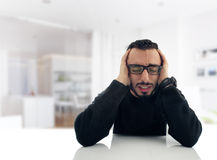 Young Businessman feeling Stressed at work Royalty Free Stock Photo