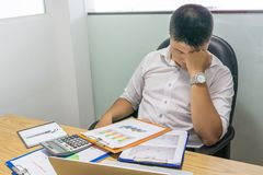 Young businessman feels headache and stressed with financial report stock photos