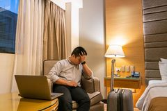 Businessman feels tired and frustrated with work in the business trip royalty free stock images