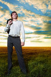 Young businessman in field Stock Photography