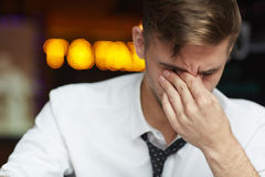 Young Businessman Fighting Tiredness at Work Royalty Free Stock Image
