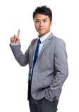 Young businessman with finger point up Royalty Free Stock Images
