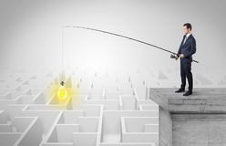 Businessman fishing new idea from a maze concept Stock Photography