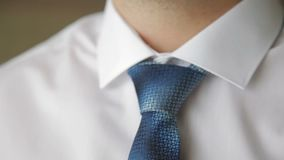 Young businessman fixing his tie stock footage