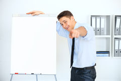 Young businessman with a flip chart on presentation Stock Photos